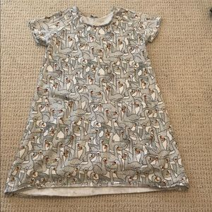 Girl's dress by Art and eden with swan print.